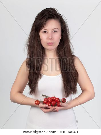 The Young Beautiful Woman With The Fresh Vegetables