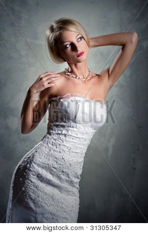 Beautiful Blond Bride Posing Indoors