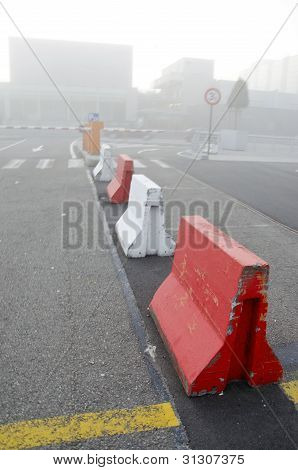City In Morning Fog. Concrete Lower Road Barriers