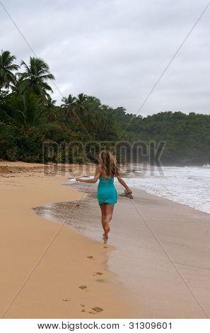 Happy Woman Running On Caribbean Beach