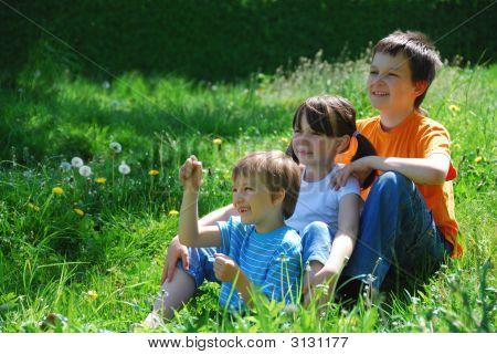 Three Kids In A Meadow
