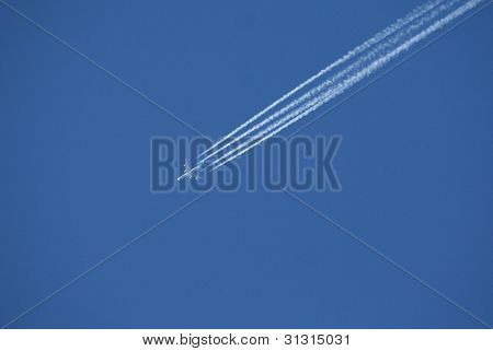 Passenger Jet With Contrails In Clear Blue Sky, Canadian Rockies,kananaskis,alberta, Canada..