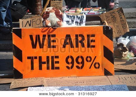 """ we are the 99%"", occuppy wallstreet movement"