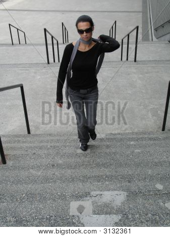 Female Walking Up Stairs