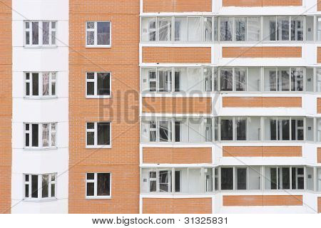 facade of red and white new dwelling building
