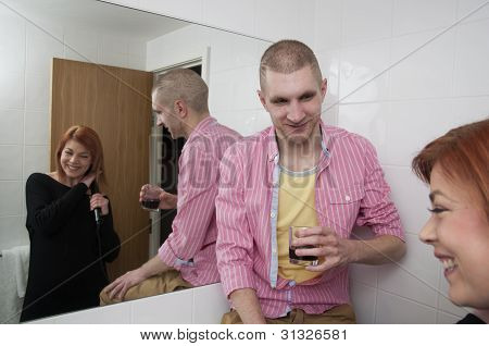 couple talking in hotel bathroom