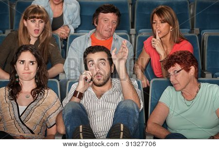 Audience Angry With Man On Phone
