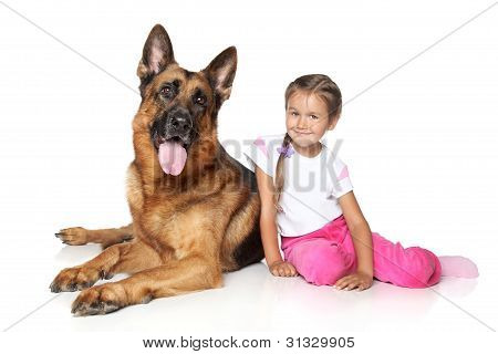 Young Girl And German Shepherd Dog