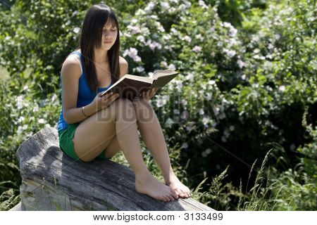Teenager Reads A Book