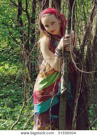 girl standing in forest