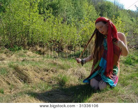 girl sitting in grass