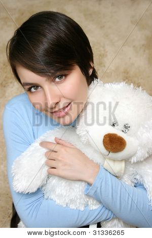 Young Woman With White Teddy Bear