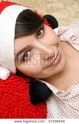 Portrait Of A Beautiful Young Woman Wearing Christmas Clothes At Home