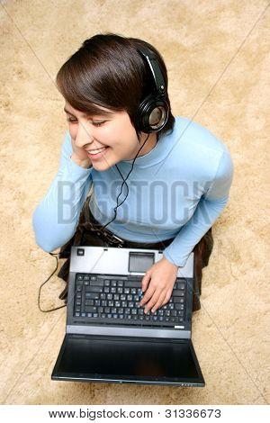 Girl Listening Music From Laptop