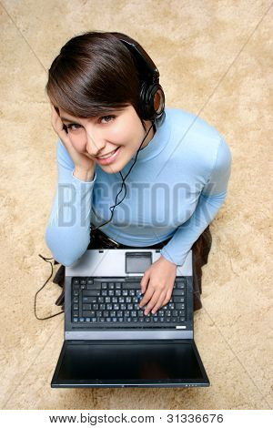 Happy Girl Listening Music From Laptop