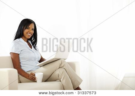 Pretty Young Woman Working On Laptop At Home