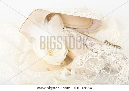 The beautiful bridal shoes, lace, bag and beads