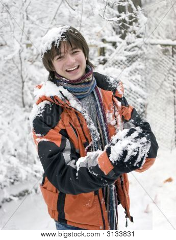 Pretty  European Teens Boy In Scarf With Snowball In Winter Outdoors (Series Sport, Extreme, Mountai