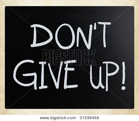 """don't Give Up"" Handwritten With White Chalk On A Blackboard"
