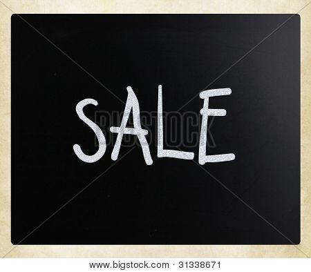 """""""sale"""" Handwritten With White Chalk On A Blackboard"""