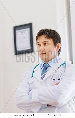 Portrait Of Thoughtful Male Medical Doctor