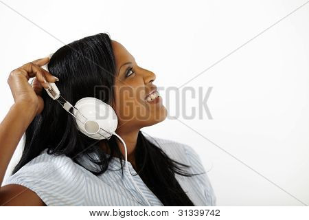 Lovely Young Female Listening To Music