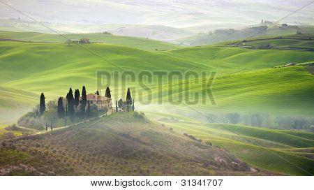 Tuscany farmhouse on hill