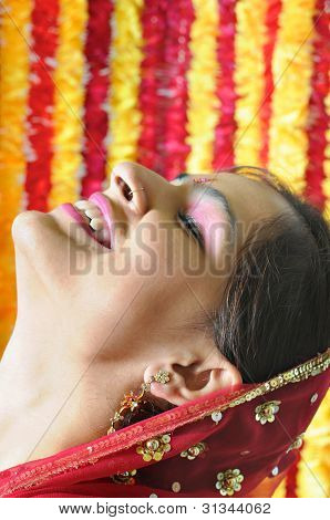Side Pose Of An Indian Lady With Closed Eyes  And Laughing In Happiness