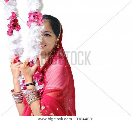Indian Girl Smiling While Swinging Over A Floral Swing.