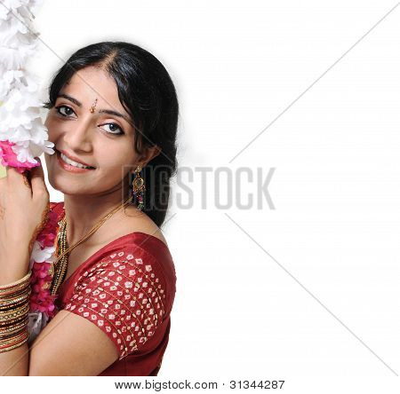 Indian Girl Sitting Over A Floral Swing.