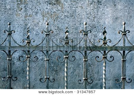 Metal Fence And A Wall
