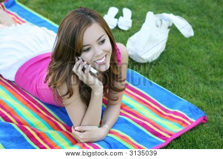 A Beautiful Young Teenage Girl In The Park