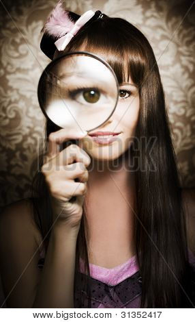 Beautiful Female Watching Through Magnifying Glass