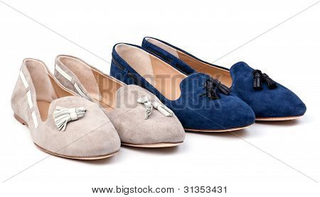 Two pairs of women suede shoes over white