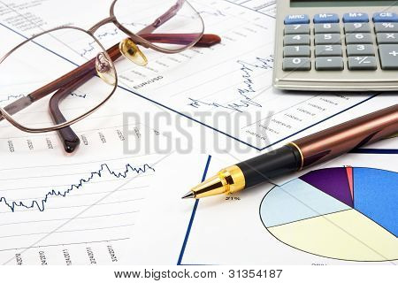 Business Background, Financial Data Concept With Pen And Glasses