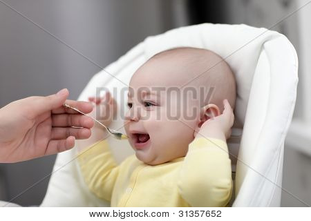Crying Baby With Food