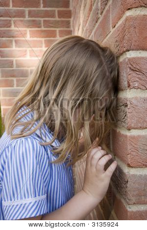 Young Child Against Brick Wall