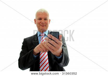Empresario con teléfono móvil aislado