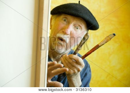Artist With A Beret At A Canvas Looking At Model