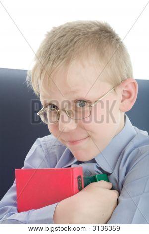 Boy In Eyeglasses Embrace Three Interesting Books