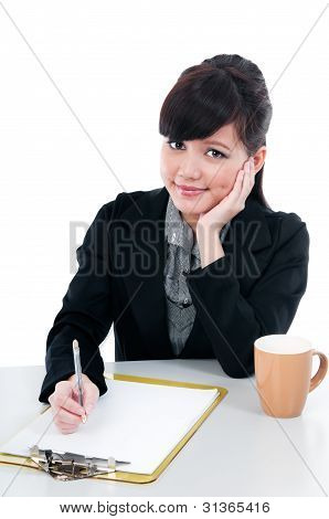 Young Business Woman Writing
