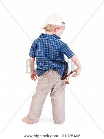 Little Boy In Cap With Slingshot In His Pocket