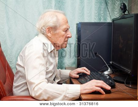 Old Man Working On Computer