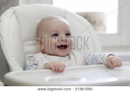 Happy Baby In Highchair