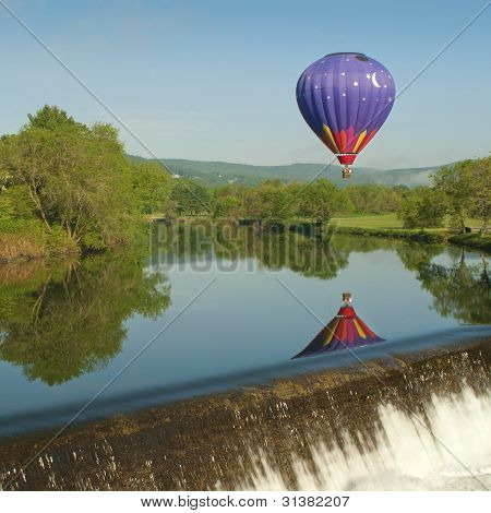 Hot Air Balloon Over A Lake