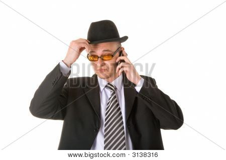 Doubtful Businessman In Hat And Glasses