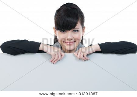 Young Businesswoman Holding Blank Billboard