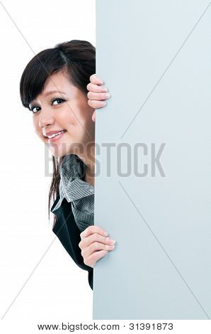 Happy Young Businesswoman Holding Blank Billboard