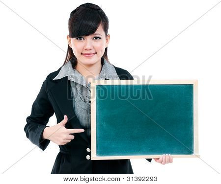 Cute Young Businesswoman Pointing At Blackboard