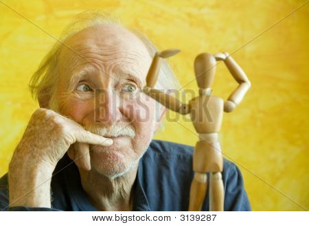 Artist Ponders A Wooden Model